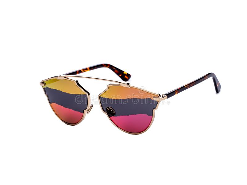 Sunglasses with colored glasses on an isolated white background royalty free stock image