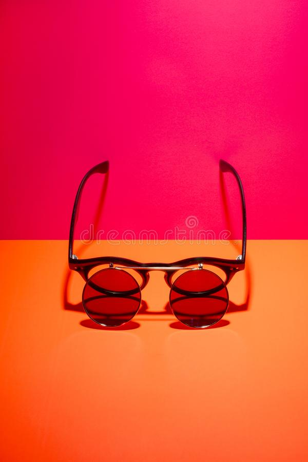 Sunglasses with double glass on a colored background.  stock photo
