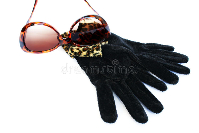 Sunglasses and gloves royalty free stock photo