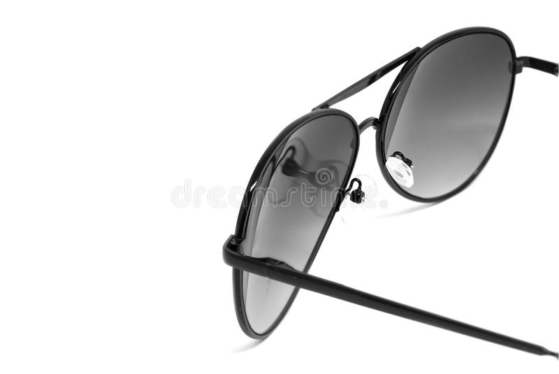 Sunglasses isolated detail. Black sunglasses on white background royalty free stock photography