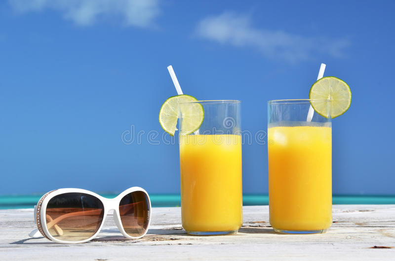 Sunglasses and juice stock images