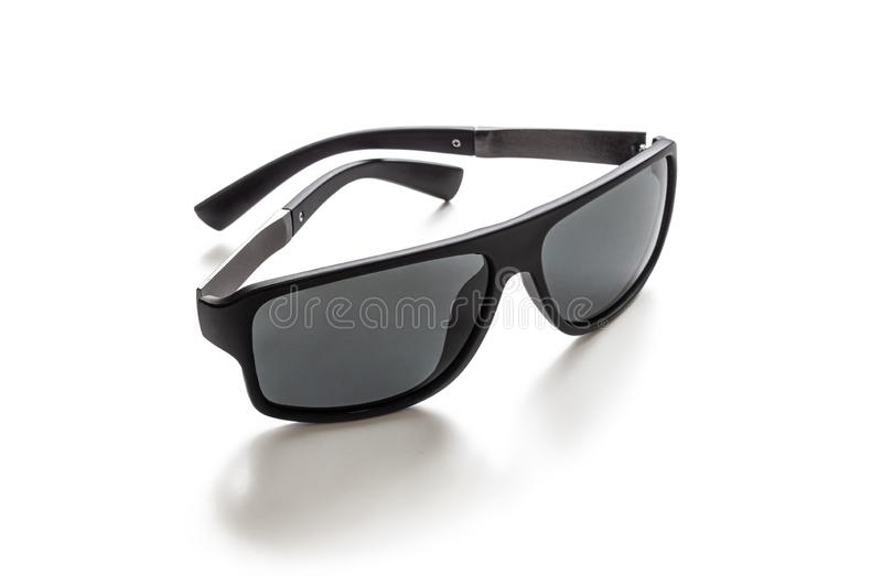 Sunglasses made of plastic, with dark lenses on white royalty free stock photos