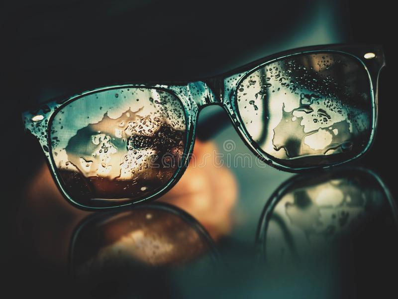 Sunglasses mirrored on wet surface stock photos