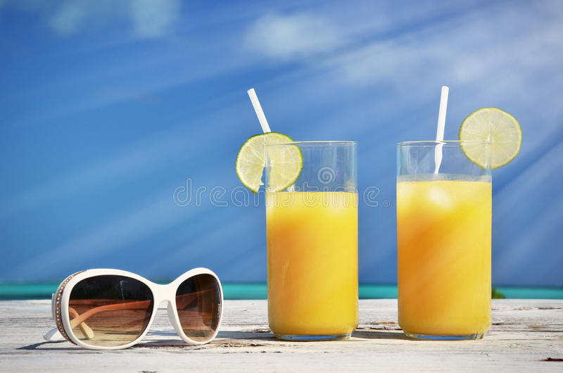 Sunglasses and orange juice royalty free stock photography