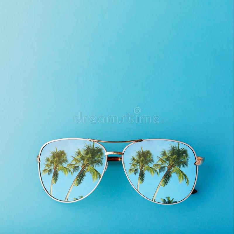 Sunglasses with palm trees reflected in them royalty free stock photo
