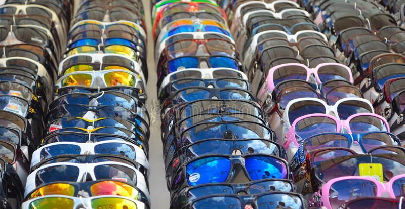 Sunglasses for sale on market stall stock photo