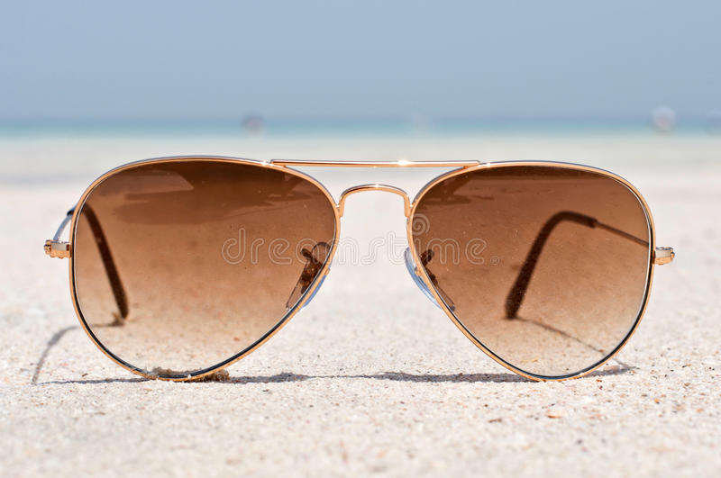 Download Sunglasses on a sand beach stock photo. Image of holiday - 41844536