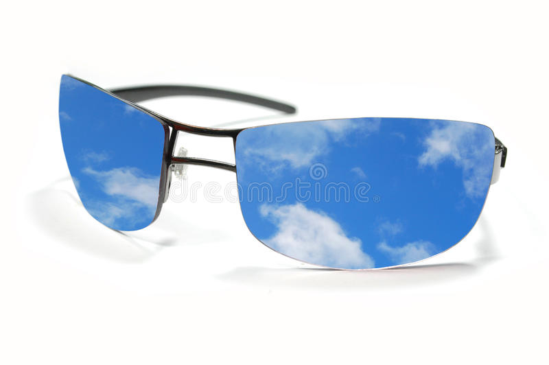 Sunglasses and sky reflection. Sky reflection inside sunglasses on a white background stock images