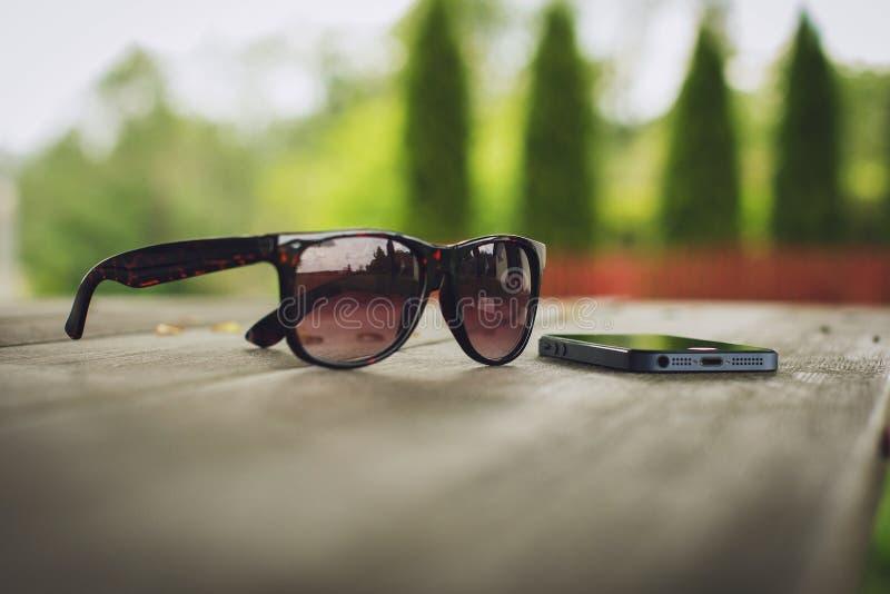 Sunglasses and smartphone stock photo