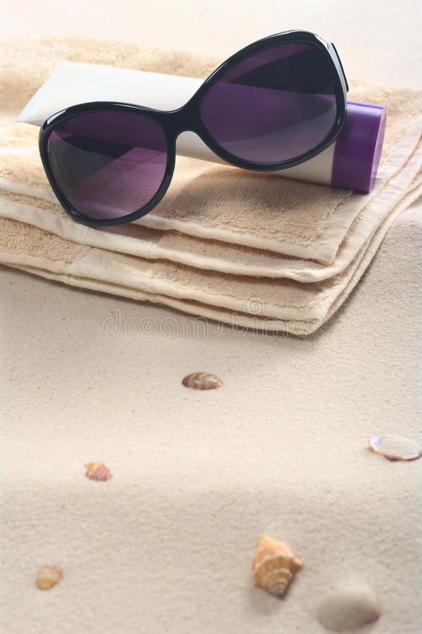 Download Sunglasses, Sunscreen And Towel On Sand Stock Photo - Image: 19842222