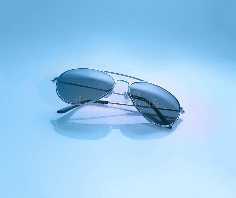 Sunglasses on trendy pink background. Sunglasses on trendy blue background. Macro shot royalty free stock image