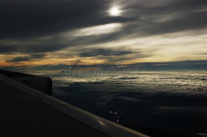 Sunglow en la nube del plano fotos de archivo libres de regalías