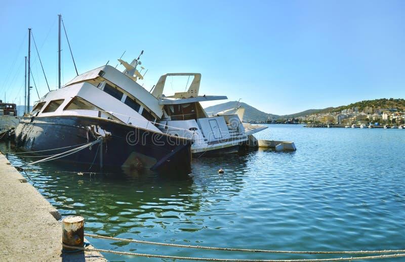 Sunk boats Salamis island Greece stock image