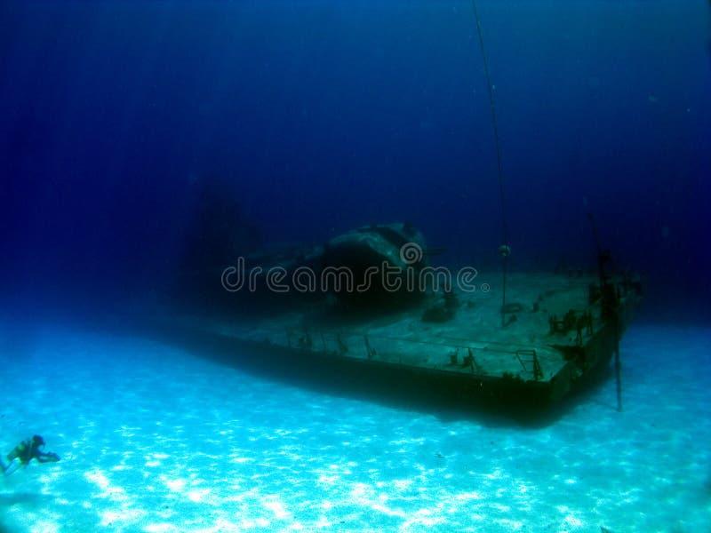 Sunken Destroyer MVP Tibbetts. Diver explores the sunken Destroyer MVP Tibbetts in Cayman Brac stock photo