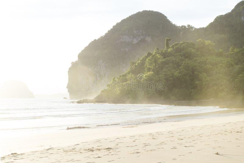 Sunlght at Hat Farang beach, Koh Mook, Thailand. Sunlght on green mountains and sand at Hat Farang beach, Koh Mook, Thailand stock photos