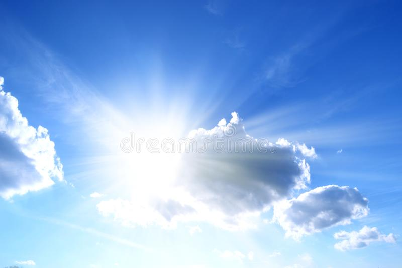 Sunlight behind the clouds in the blue sky royalty free stock photos