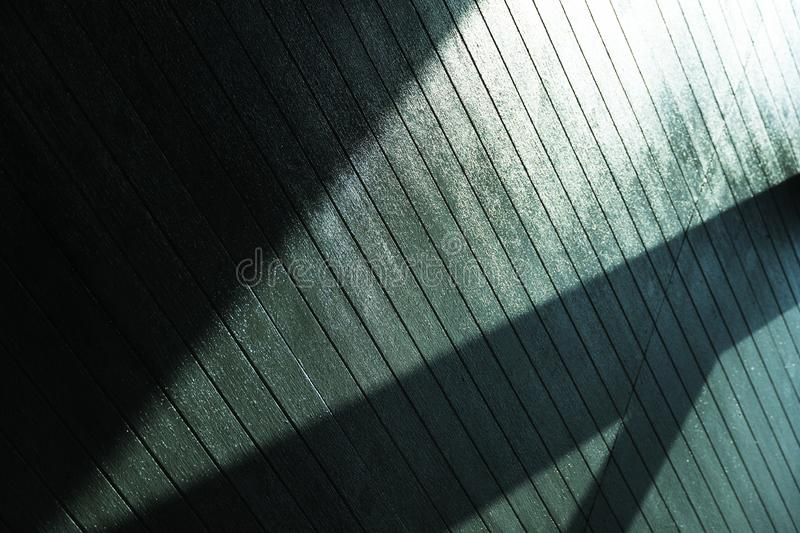 Sunlight from ceiling reflection and silhouette shadow abstract architecture detail background royalty free stock image