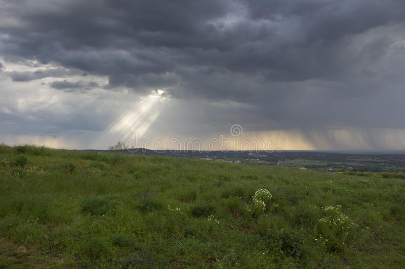 Sunlight coming through clouds royalty free stock photo