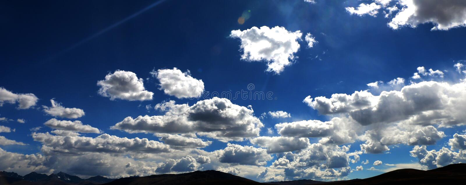 Sunlight Crosing The Clouds and Blue Sky stock photo