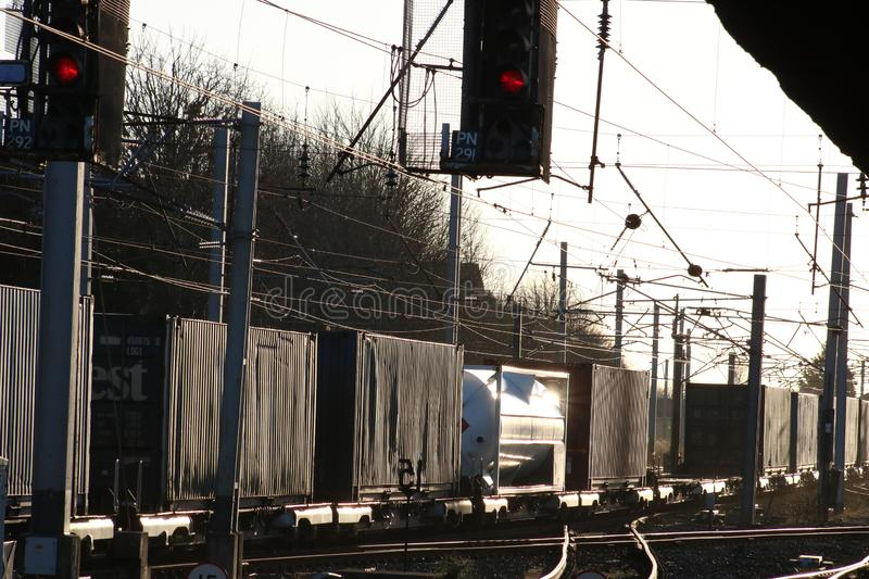 Sunlight glinting off containers on freight train on WCML stock images