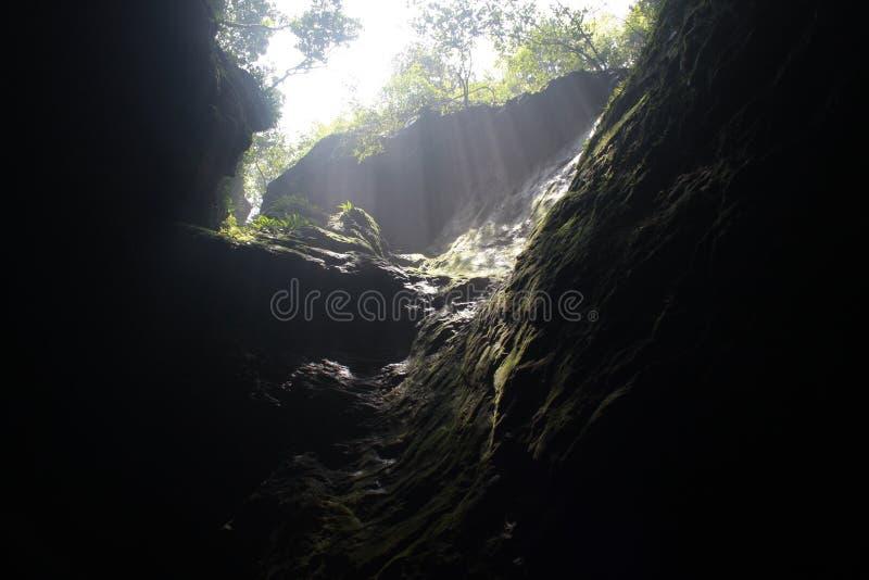 Sunlight through a mouth of a hole stock photos