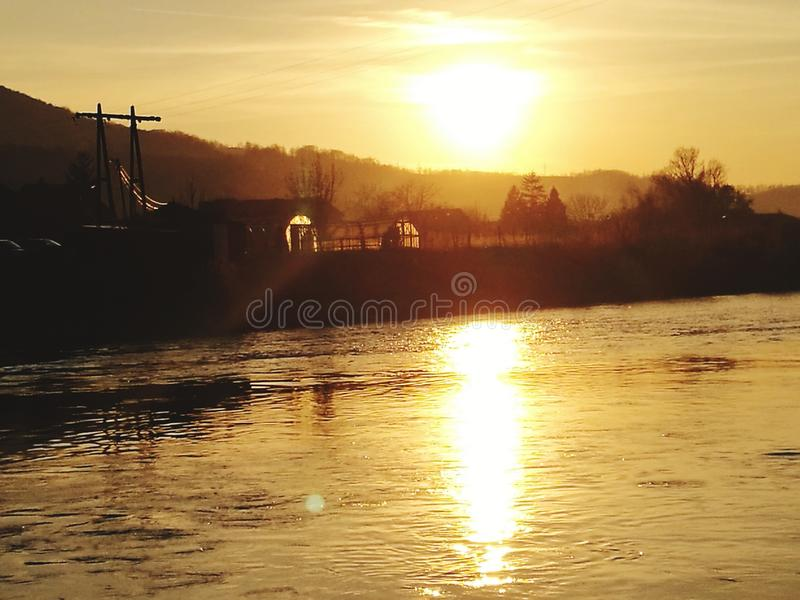 Sunlight over river stock images
