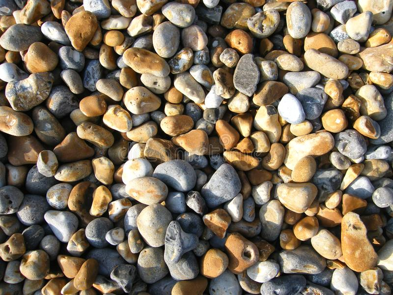 Sunlight on pebbles royalty free stock image