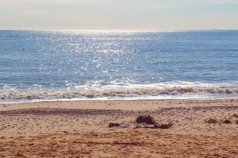 Sunlight reflecting on sparkling blue sea at Southwold beach in the UK. Sunlight reflecting on sparkling blue sea at Southwold beach, a popular seaside town of royalty free stock images