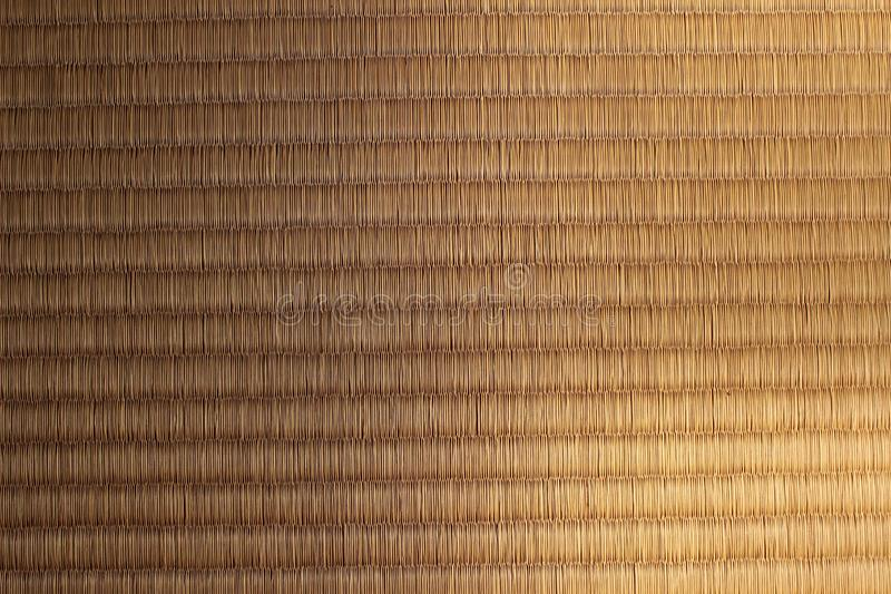 Light and shade on a Japanese tatami mat. Sunlight and shade on a texture of Japanese tatami mat royalty free stock photography