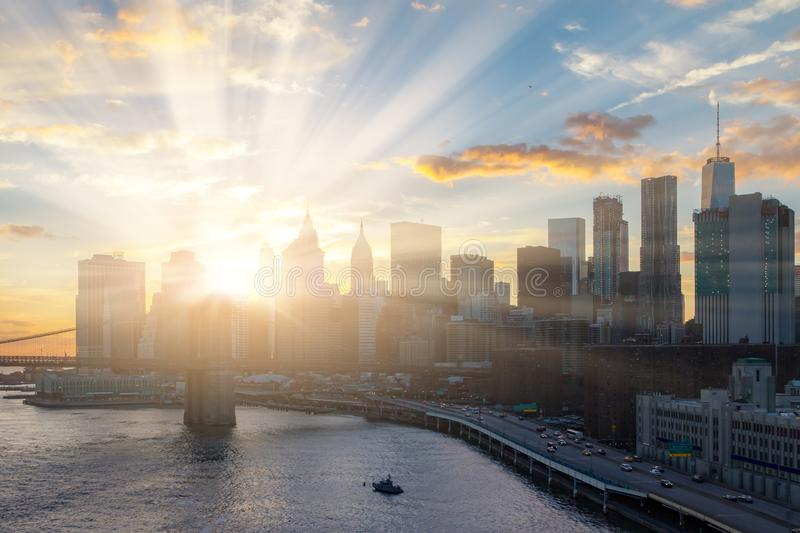 Sunlight shines behind New York City skyline stock photography