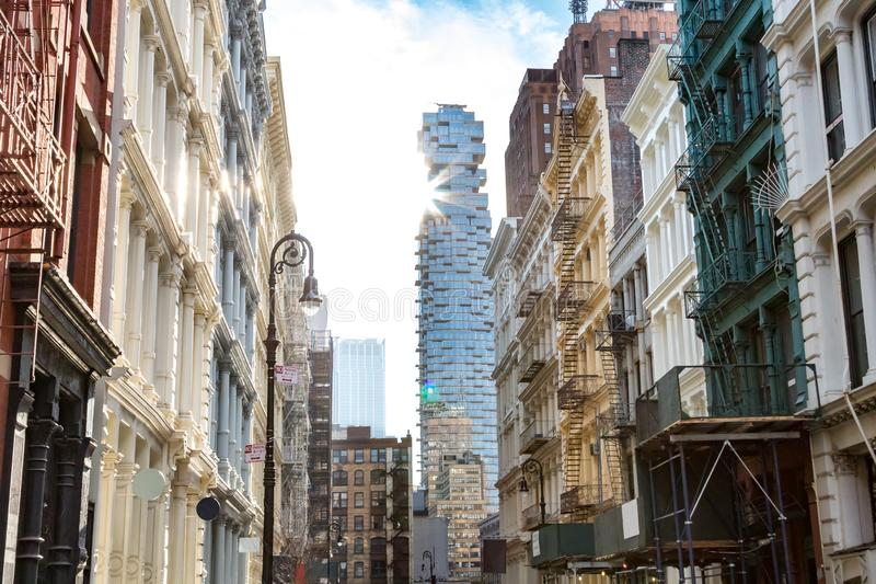Sunlight shines on the buildings along Greene Street in New York City stock photography