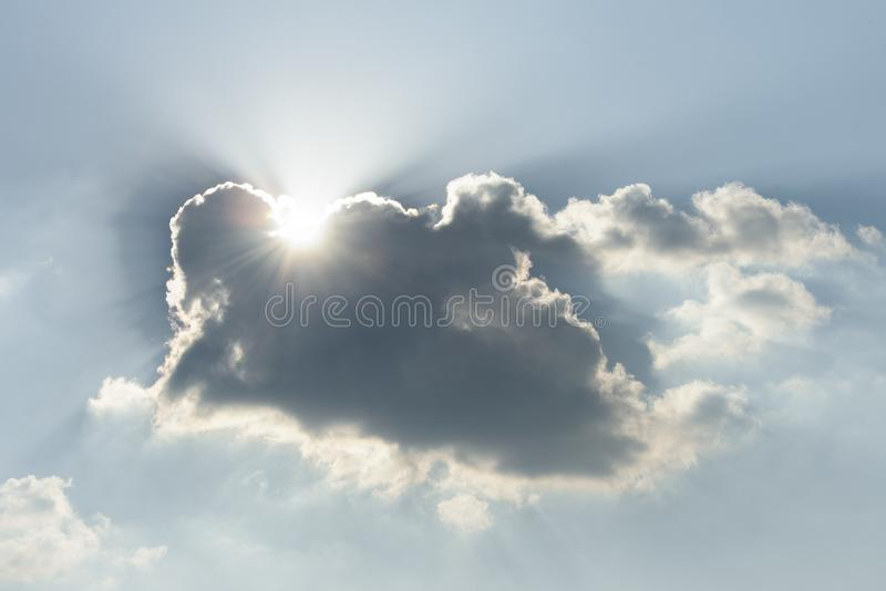 Sunlight shines clouds,eautiful background - sunset sky. Sunlight shines clouds,Beautiful background - sunset sky, bright sun shines through clouds,Rays of light royalty free stock images
