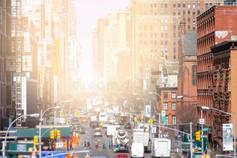 Sunlight shines down the busy streets of Chelsea in New York City royalty free stock photo