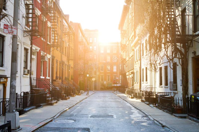 Sunlight shines on historic buildings along Gay Street in New York City royalty free stock photo