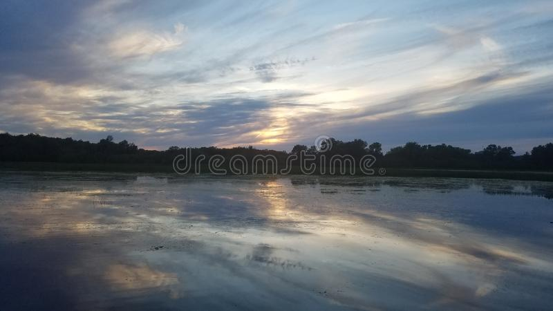 Clouds reflecting on the river royalty free stock image