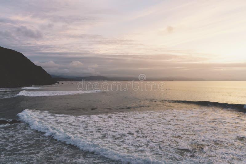 Sunlight sunset on horizon ocean on background seascape rays sunrise. Relax view waves sea on evening sand beach, sun light flare. Nature evening outdoor stock photography