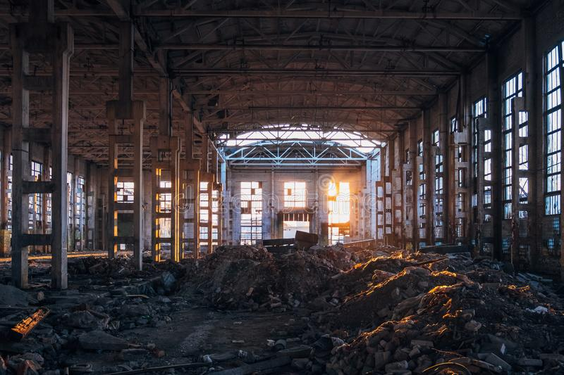 Sunlight of sunset in large abandoned industrial building of Voronezh excavator factory stock image