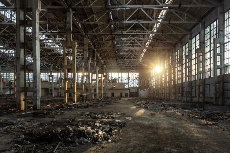 Sunlight of sunset in large abandoned industrial building of Voronezh excavator factory stock photo