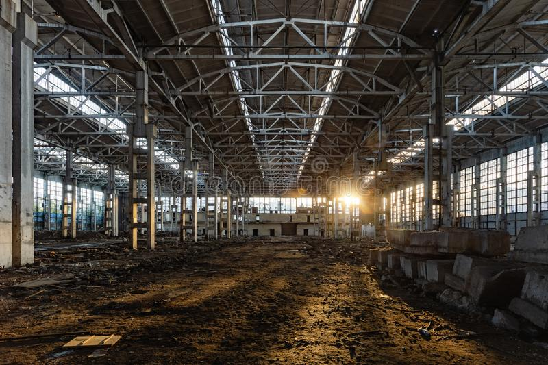 Sunlight of sunset in large abandoned industrial building of Voronezh excavator factory royalty free stock photos
