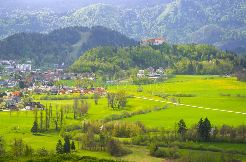 Sunlit alpine valley and slovenian village at spring day royalty free stock image