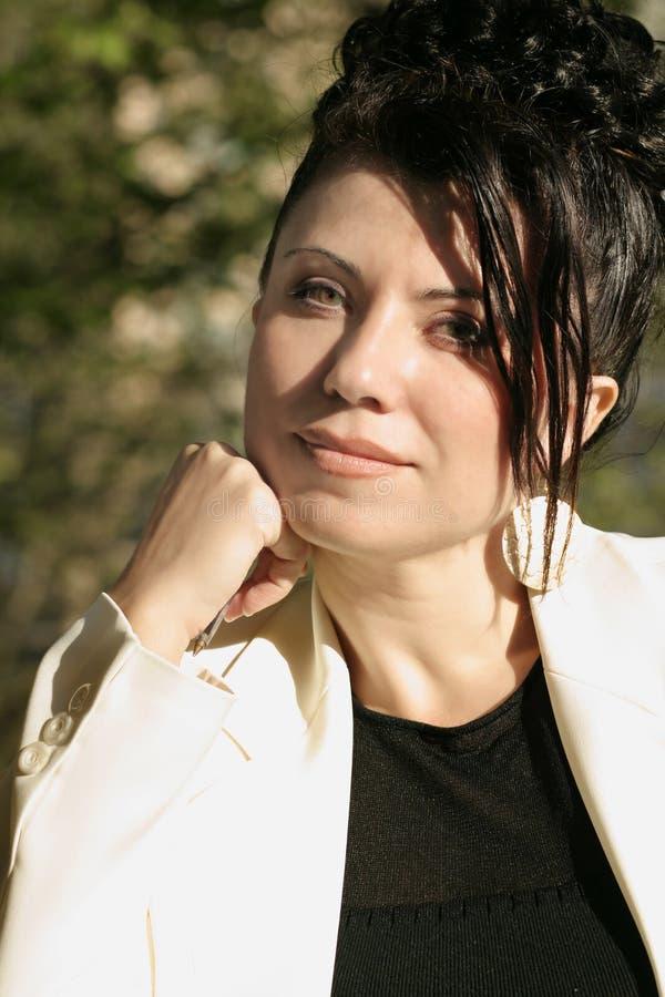 Sunlit businesswoman. Businesswoman in sunlight stock photography