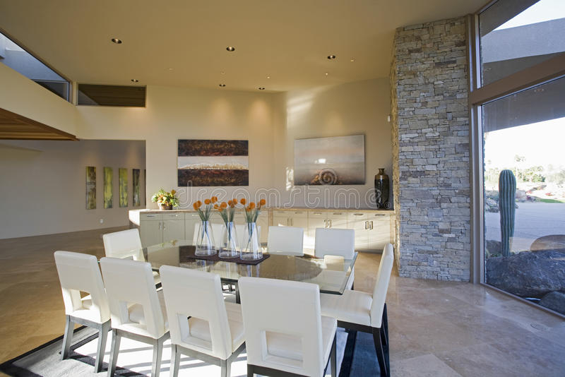 Sunlit Dining Room. View of a modern sunlit dining room o spacious house stock images