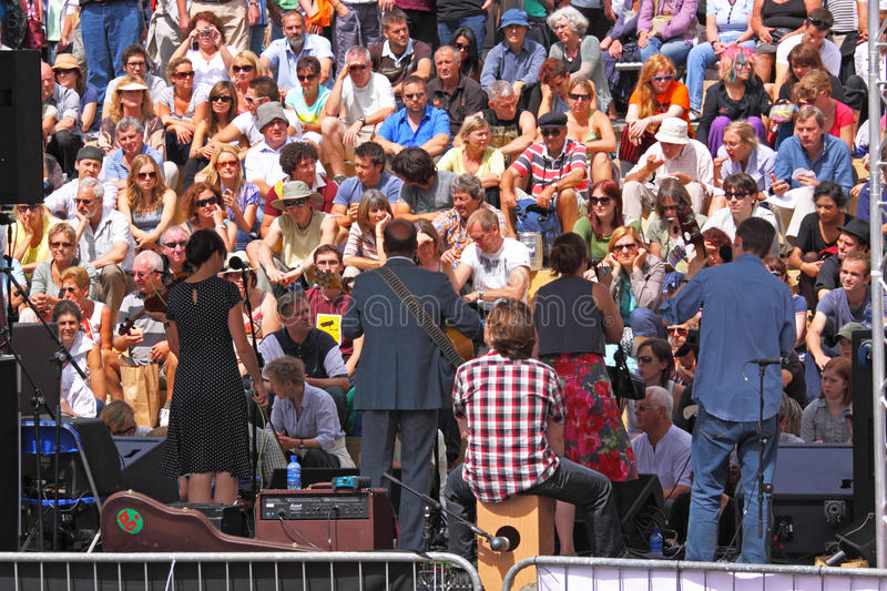 Sunlit Harbour Festival Crowd royalty free stock image