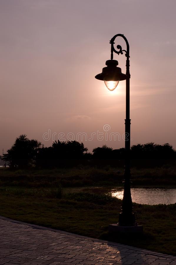 Free Sunlit Lamp Post On A Dreamy Afternoon Royalty Free Stock Photography - 66925657