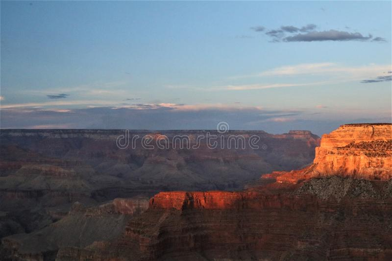 Sunlit layers in the Grand Canyon. A sliver of late afternoon sun spotlights the dramatic form and color of this rock formation in the Grand Canyon royalty free stock image