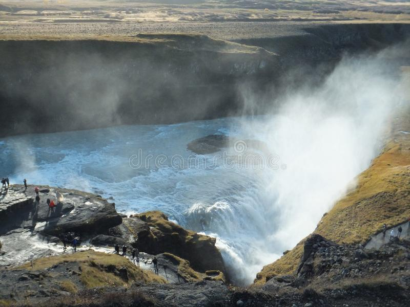 Sunlit mist rising above Gullfoss waterfall in Iceland on a bright sunny day royalty free stock photography