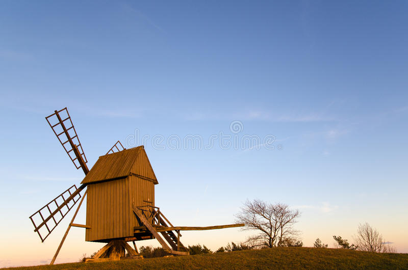 Sunlit old traditional windmill stock photos