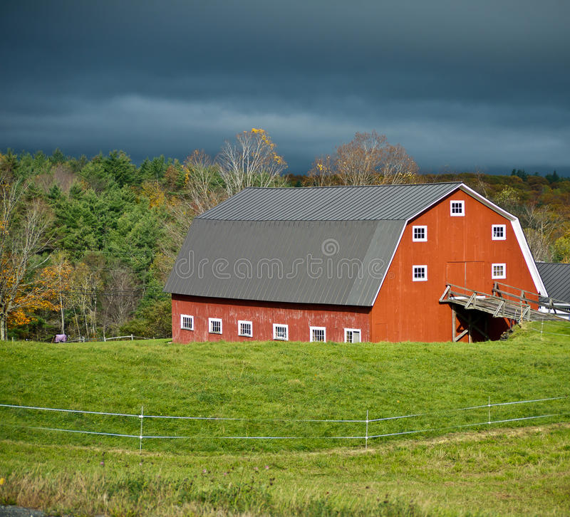 Download Sunlit Red Barn And Stormy Skies Stock Image - Image: 21671757