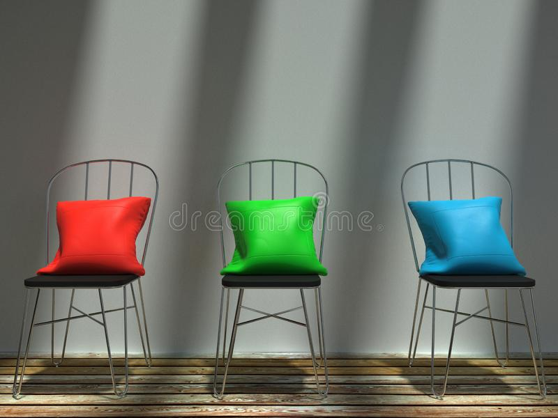 Sunlit red, green and blue cushions on metal chairs royalty free stock images