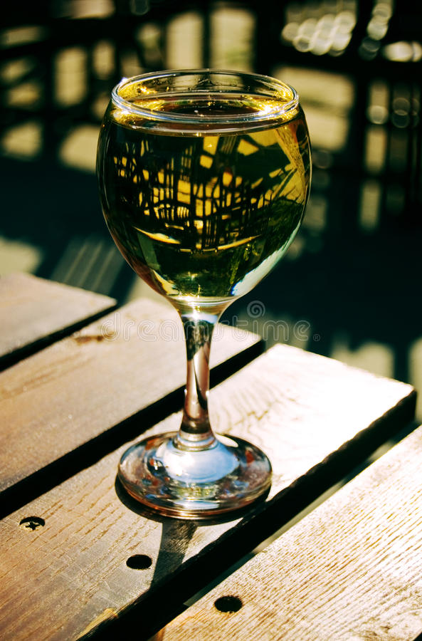 Download Sunlit White Wine Glass On A Wooden Table Stock Image - Image: 11092705